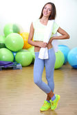 Pretty sporty girl in fitness room — Stock Photo