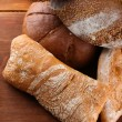 Much bread on wooden board — Stock Photo #30933701