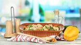 Casserole with vegetables and meat, on wooden table, on bright background — Stock Photo