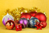 Christmas decorations on yellow background — Stock Photo