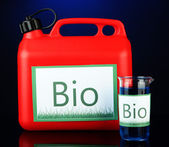 Bio fuels in canister and vials on blue background — Stock Photo