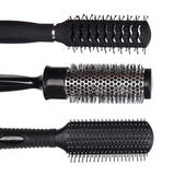 Black combs isolated on white — Stock Photo