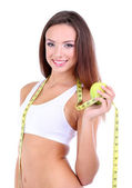 Beautiful young woman with green apple and measuring tape isolated on white — Stock Photo