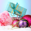 Beautiful Christmas balls and gifts on snow on bright background — Стоковое фото #31012459