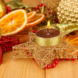 Christmas composition with candles and decorations on wooden background — Stock Photo