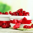 Stock Photo: Fresh cornel berries in white cups on wooden table