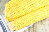 Crude corns on napkin on wooden table — Stock Photo