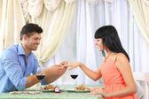Beautiful couple having romantic dinner at restaurant — Стоковое фото
