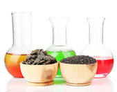 Beakers with bio fuel from rape seeds, oil cakes, isolated on white — Stock Photo