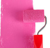 Roller brush with pink paint — Stock Photo