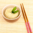 Asian noodles in bowl on bamboo mat — Stock Photo