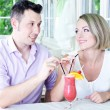 Beautiful couple drinking together cocktail at restaurant — Stock Photo #31021865