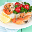 Stock Photo: Boiled crab claws on white plate with salad leaves and tomatoes,on wooden table background