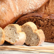 Much bread on wooden board — Stock Photo #31022209