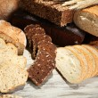 Much bread on wooden board — Stock Photo #31022217