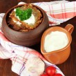 Potato pancakes in pot, on wooden background — Stock Photo #31022837