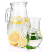 Cold water with lemon, cucumber and ice in pitchers isolated on white — ストック写真