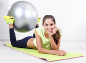 Beautiful young girl doing exercises at home — Stock Photo
