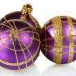 Beautiful purple Christmas balls isolated on white — Stock Photo