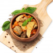 Homemade beef stir fry with vegetables in color bowl, on wooden board, isolated on white — Стоковая фотография