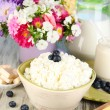 Stock Photo: Fresh cottage cheese with blueberry on wooden table close-up