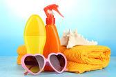 Beach items on beach background — Stock Photo