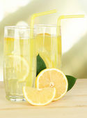 Delicious lemonade on table on light background — Stock Photo