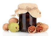 Bank of jam walnuts isolated on white background — Stock Photo