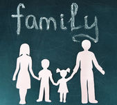 Familj från papper på ljus bakgrund — Stockfoto