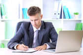 Portrait of young businessman working in office — Stock Photo