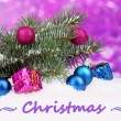 Christmas ball and toy with green tree in the snow on purple background — Foto de Stock