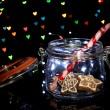 Tasty cookies in glass bottle on blur lights background — Stock Photo #31123171