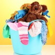 Blue laundry basket on orange background — Stock Photo
