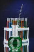 Laboratory glassware on dark color background — Stock Photo