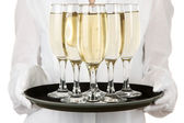 Waitresses holding tray with glasses of champagne, isolated on white — Stock Photo