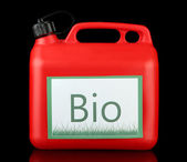 Bio fuels in canister on black background — Stock Photo