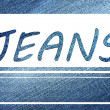 Stock Photo: Inscription Jeans on jeans background