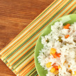 Risotto on color plate on wooden background — Stock Photo #31282111