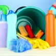 Stock Photo: Cleaning items in bucket on color background