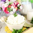 Stock Photo: Fresh cottage cheese with greens on wooden table close-up