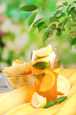 Iced tea with lemon and mint on table, outdoors — Stock Photo