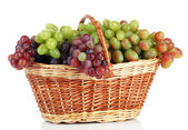 Fresh grape in wicker basket, isolated on white — Stock Photo