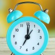 Alarm clock on table on bright background — Foto Stock