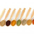 Assortment of spices in wooden spoons, isolated on white — Stock Photo #31292651