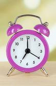 Alarm clock on table on light background — Stock Photo