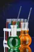 Laboratory glassware on dark color background — Stok fotoğraf