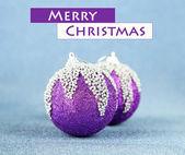 Christmas balls on blue background — Stock Photo