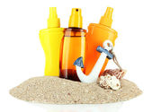 Bottles with suntan cream, isolated on white — Stock Photo