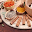 Various spices and herbs on wooden table — Stock Photo