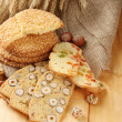 Stock Photo: Homemade cookies with sesame seeds and Italibiscuit, on wooden table, on sackcloth background